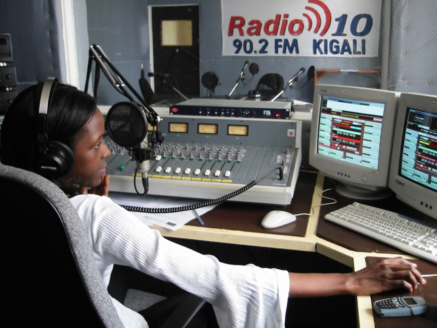 KIGALI, RWANDA - 3APR04 - Marie NoÎl Mugema hosts an English-language country music show on Radio 10, the first private radio station in the country since the 1994 genocide.  PHOTO: Mary Wiltenburg